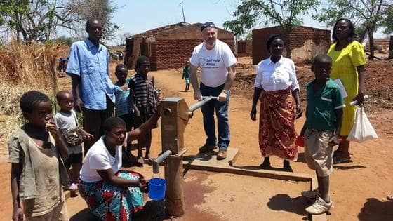 Ronan scully of gorta self help africa with beneficiaries in malawi  2
