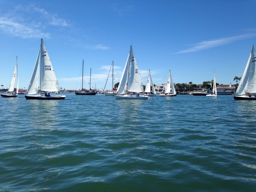 Newport Harbor Public Anchorage // sailing classes coming close to the anchored boats.