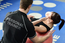 Small personal trainer and client