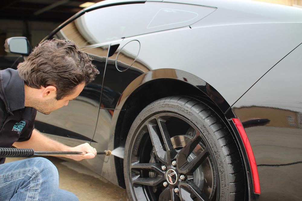 Car wash with spray