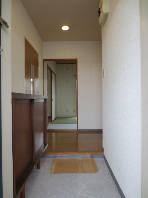 メルベーユ三芳野 203号室の玄関