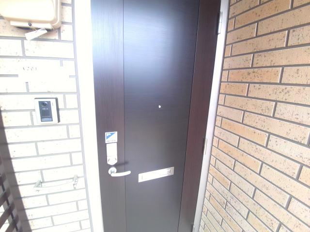 エクセル α(アルファ) 201号室の玄関