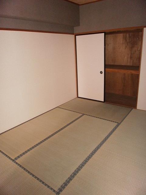 ビューラーあけぼの 102号室のベッドルーム