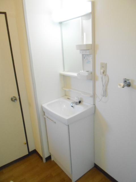 メゾン八木崎 101号室の洗面所