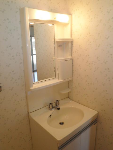 コーポラス小山 302号室の洗面所