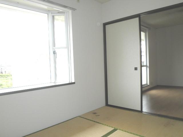 コージコート 201号室の居室