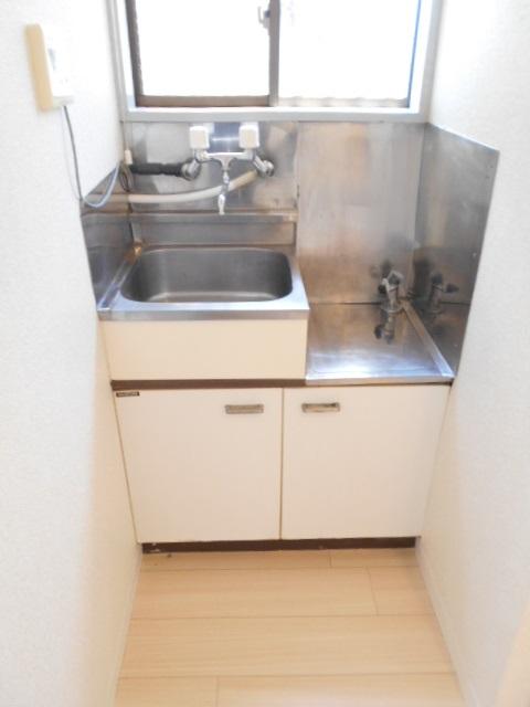 アーバンハイツ高幡 203号室のキッチン