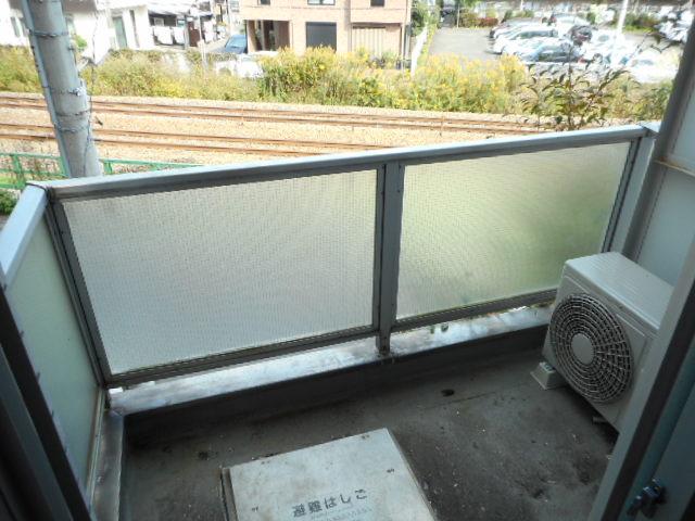 キャトルセゾン橋本Ⅱ 305号室のバルコニー