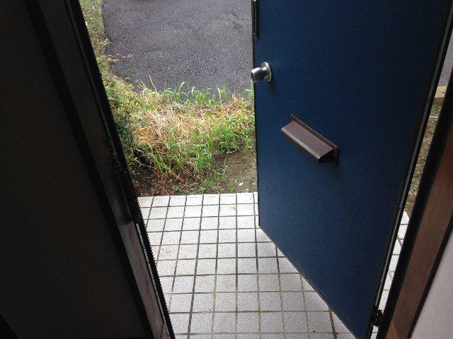 ハイネス椿の玄関