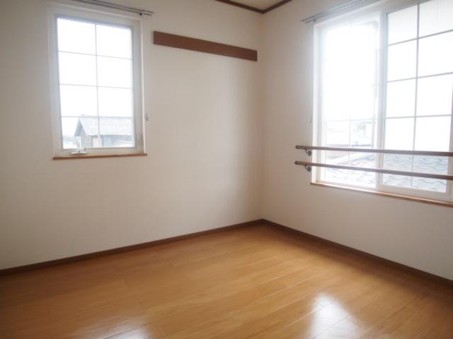 アヴェニールイズミ 01030号室の居室