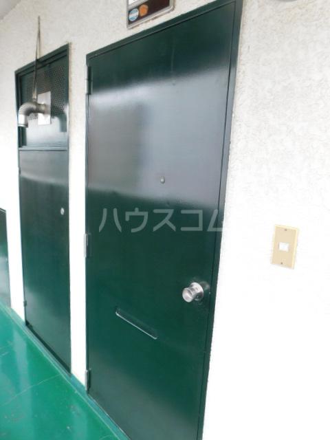 エスカイア上尾 402号室の玄関