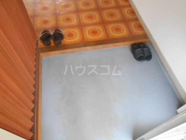 ニューサンシャインホリコシ 303号室の玄関