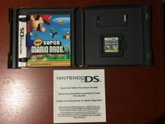 Inside Box With Instruction Manuals And Game | New Super Mario Bros Nintendo DS