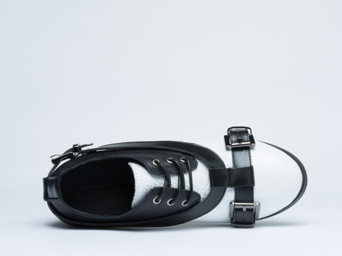 Depression In White Black Strap Buckle Shoes
