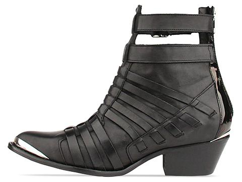 To Be Announced In Black Leather Esther
